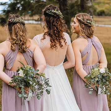 Bridesmaids with flowers at voco